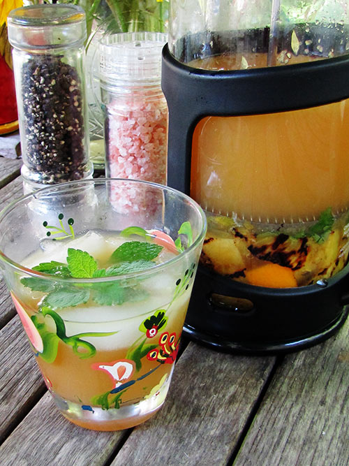 Citrus whiskey cocktail in coffee press