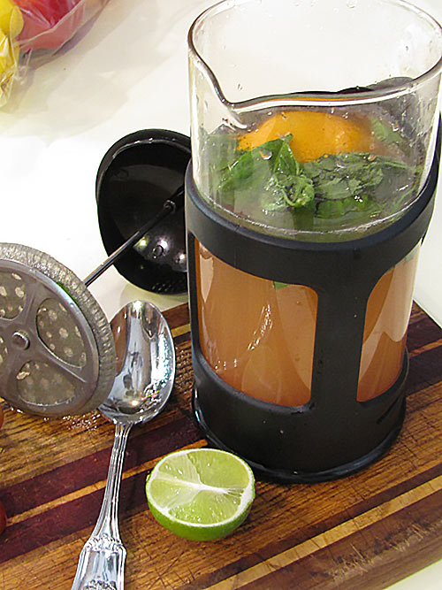 Grapefruit basil cocktail in coffee press